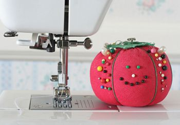 smiling pin cushion