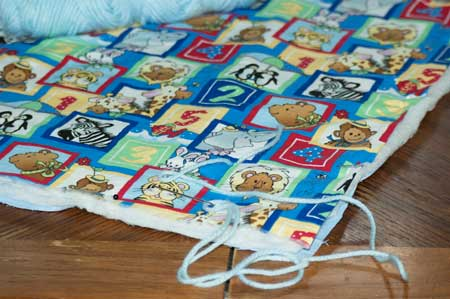 tying baby blanket quilt