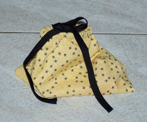 drawstring bag with buttonhole