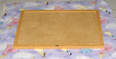 laying out bulletin board on fabric