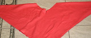 triangle poncho laid out flat