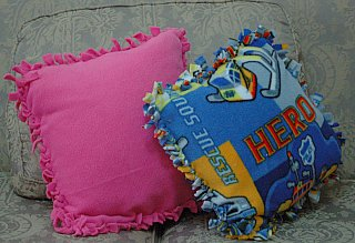 2 fleece pillows tied