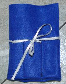 felt organizer tied with ribbon