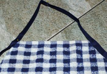 pin top of towel apron