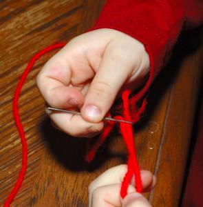 threading a yarn needle