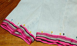 pin ribbon to bottom of pants
