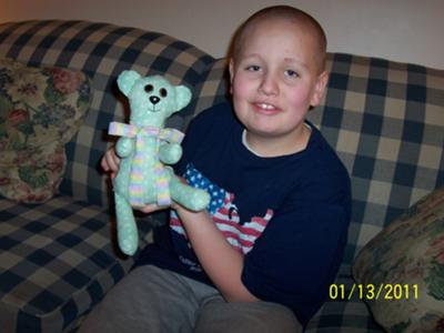 This is me, Adam, and the polka-dot bear I made.